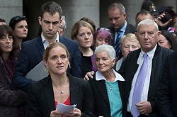 © Licensed to London News Pictures. 23/11/2016. London, UK. Family of murdered MP Jo Cox speak to reporters outside The Old Bailey after Thomas Mair was found guilty of her murder. Jo Cox's sister Kim Leadbetter (2L) speaks as Jo's husband Brendan Cox and parents Jean and Gordon Leadbeater look on. Defendant Thomas Mair chose not to give any evidence in his defence.  Mair shot and stabbed the 41-year-old Member of Parliament outside her constituency surgery in Birstall, near Leeds, Yorkshire on June 16 this year and has been given a whole life sentence. Photo credit: Peter Macdiarmid/LNP