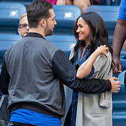 2019 US Open Tennis Tournament- Day Thirteen.    Meghan Markle, Duchess of Sussex is greeted by Alexis Ohanian, husband of Serena Williams as she arrives at the court side team box before the Women's Singles Final on Arthur Ashe Stadium during the 2019 US Open Tennis Tournament at the USTA Billie Jean King National Tennis Center on September 7th, 2019 in Flushing, Queens, New York City.  (Photo by Tim Clayton/Corbis via Getty Images)
