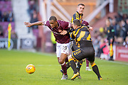Uche Ikpeazu (#19) of Heart of Midlothian looks to escape the clutches of William Lyle (#2) of Auchinleck Talbot FC during the William Hill Scottish Cup match between Heart of Midlothian FC and Auchinleck Talbot FC at Tynecastle Stadium, Edinburgh, Scotland on 10 February 2019.