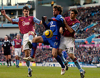 Photo: Glyn Thomas.<br />Aston Villa v Manchester United. The Barclays Premiership.<br />17/12/2005.<br />Aston Villa's Liam Ridgewell (L) and Aaron Hughes are unable to prevent Ruud van Nistelrooy (C) from gaining possession.