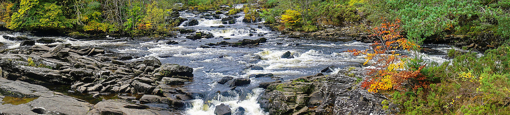 Part of the meandering cascades of the Falls of Dochart that run through the small town of Killin, in Loch Lomond & The Trossachs National Park, Scotland, and located at the western end of Loch Tay,
