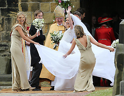 A gust of wind blows Lady Melissa Percy's dress as she arrives for her wedding to Mr.Thomas van Straubenzee , with bridesmaid Chelsy Davy (left) at St.Michaels Church, Alnwick, Northumberland,  Saturday, 22nd June 2013<br /> Picture by:  Stephen Lock / i-ImagesBridesmaid Chelsy Davy at the Lady Melissa Percy and Thomas van Straubenzee wedding at St.Michaels Church, Alnwick, Northumberland after their wedding ,Saturday, 22nd June 2013<br /> Picture by:  Stephen Lock / i-ImagesBridesmaid Chelsy Davy (left) at the Lady Melissa Percy and Thomas van Straubenzee wedding at St.Michaels Church, Alnwick, Northumberland after their wedding ,Saturday, 22nd June 2013<br /> Picture by:  Stephen Lock / i-Images