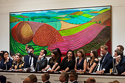 © Licensed to London News Pictures. 26/06/2018. LONDON, UK. Sotheby's staff making bids on behalf of telephone bidders in front of ''Double East Yorkshire'' by David Hockney, (Est. £10,000,000 - 15,000,000) which sold for a hammer price of £9,800,000 at Sotheby's Contemporary art evening sale in New Bond Street.  Photo credit: Stephen Chung/LNP''