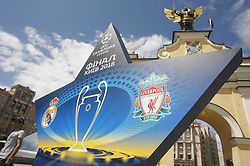 May 18, 2018 - Kiev, Ukraine - A man walks near a large sign showcasing the logo for the 2018 UEFA Champions League Final in central Kiev, Ukraine, 18 May, 2018. The football UEFA Champions League final match between Real Madrid and Liverpool FC next May 26 at the NSC Olimpiyskiy Stadium. (Credit Image: © Str/NurPhoto via ZUMA Press)