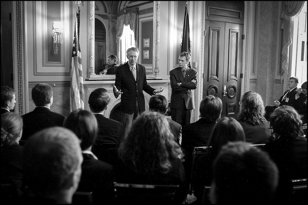 Senate Majority Leader Tom Daschle listens as Senate Majority Whip Harry Reid talks to Senate pages about the terrorist events of recent days, what it means to the Senate and their jobs and life.   9/17/01