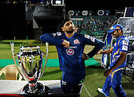 Harbhajan Singh of Mumbai Indians poses with the CLT20 2013 trophy as captain Rohit Sharma passes by after the toss before the start of the match 1 of the Karbonn Smart Champions League T20 (CLT20) 2013  between The Rajasthan Royals and the Mumbai Indians held at the Sawai Mansingh Stadium in Jaipur on the 21st September 2013<br /> <br /> Photo by Pal Pillai-CLT20-SPORTZPICS <br /> <br /> Use of this image is subject to the terms and conditions as outlined by the CLT20. These terms can be found by following this link:<br /> <br /> http://sportzpics.photoshelter.com/image/I0000NmDchxxGVv4