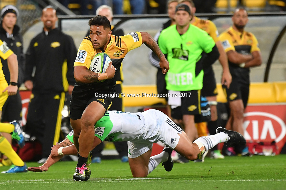 Hurricanes' Vince Aso runs out of a tackle by Highlanders' Rob Thompson during the Hurricanes vs Highlanders Super Rugby match at Westpac Stadium in Wellington on Saturday the 18th of March 2017. Copyright Photo by Marty Melville / www.Photosport.nz
