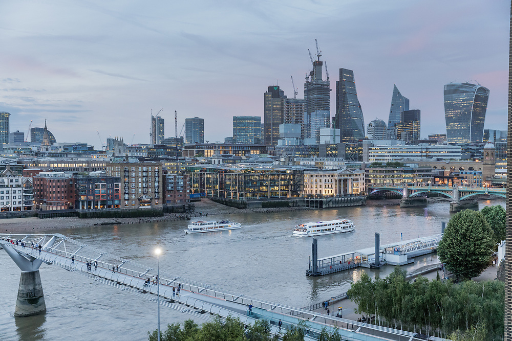 London, England, UK, June 15 2018 - Skyscrapers of the City, Thames River and Millennium Bridge as seen from the south bank of the river.