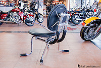 Chair made from reused Harley Davidson motorcycle parts. Shown here at Bald Eagle Harley Davidson in Marquette, MI, USA. It is now in use at the Handlebar in Singapore.