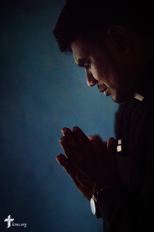 The Rev. P. Gnanakumar prays as he visits church members on the Eila rubber plantation in the Sabaragamuwa Province of Sri Lanka on Saturday, Jan. 20, 2018. LCMS Communications/ Erik M. Lunsford
