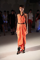 A model walks the runway wearing Mandy Coon Spring 2011 Collection during Mercedes Benz Fashion Week in New York on September 9, 2010