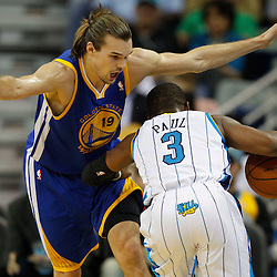 January 5, 2011; New Orleans, LA, USA; New Orleans Hornets point guard Chris Paul (3) drives into Golden State Warriors center Louis Amundson (19) during the second half at the New Orleans Arena. The Warriors defeated the Hornets 110-103.  Mandatory Credit: Derick E. Hingle