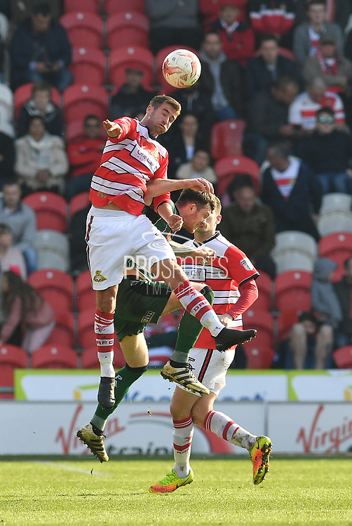 Matty Blair (17) Doncaster Rovers midfielder heads ball  during the EFL Sky Bet League 2 match between Doncaster Rovers and Plymouth Argyle at the Keepmoat Stadium, Doncaster, England on 26 March 2017. Photo by Ian Lyall.