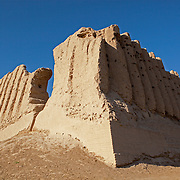 The corrugated walls of Greater Kyz Kala, a palace in Merv, Turkmenistan. Merv is the site of several ancient cities founded over the millennia, now a UNESCO World Heritage Site archaeology park in Turkmenistan.  It is the country's biggest tourist destination, as Merv was a major silk road city in its day, and according to some British archaeologists, it was the world's biggest city in the mid 12th century (and was at least the 3rd largest).  It was one of the Islamic world's greatest centres of learning, with 12 libraries and countless books.  It also appears to have been the furthest west point that Buddhism ever reached, with the discovery of a Buddha head statue in a complex within one of the older city walls -- quite possibly a meditation complex or monastery. The city may have been home to up to 1 million people when it was sacked by the Mongols.  The city surrendered, but the invaders killed all its inhabitants, and despite the attempt to revive it during Timur's empire, the city never flourished again.  Now a modern soviet town, Mary, is nearby.
