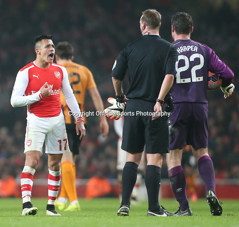 04 January 2015 - FA Cup Third Round - Arsenal v Hull City - Alexis Sanchez of Arsenal argues with referee after he gets a booking.<br /> <br /> Photo: Ryan Smyth/Offside