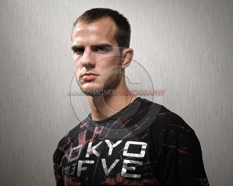 A portrait of mixed martial arts athlete Cole Miller
