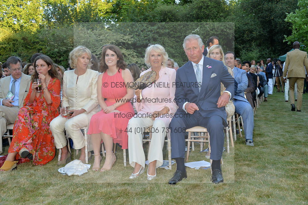 Left to right, AYESHA SHAND, ANNABEL ELLIOT, PRINCESS EUGENIE OF YORK, THE DUCHESS OF CORNWALL and THE PRINCE OF WALES at the Quintessentially Foundation and Elephant Family 's 'Travels to My Elephant' Royal Rickshaw Auction presented by Selfridges and hosted by HRH The Prince of Wales and The Duchess of Cornwall held at Lancaster House, Cleveland Row, St.James's, London on 30th June 2015.
