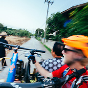Andrew Whiteford and Jay Goodrich get a ride on local motorbike with side car near Chiang Dao, Thailand.