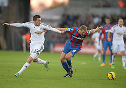 Crystal Palace's Brede Hangeland shields the ball from Swansea City's Gylfi Sigurosson - Photo mandatory by-line: Alex James/JMP - Mobile: 07966 386802 - 29/11/2014 - Sport - Football - Swansea -  - Swansea v Crystal palace  - Barclays Premier League