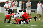 BEREA, OH - AUGUST 3:  Defensive back Chris Thompson #38 of the Cleveland Browns upends rookie wide receiver Travis Wilson #81 (the Browns third round pick in the 2006 NFL Draft) on a pass play during training camp at the Cleveland Browns Training and Administrative Complex on August 3, 2006 in Berea, Ohio. ©Paul Anthony Spinelli *** Local Caption *** Chris Thompson;Travis Wilson