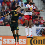 Thierry Henry, (right), New York Red Bulls, wins a header while challenged by Jack Jewsbury, Portland Timbers, during the New York Red Bulls Vs Portland Timbers, Major League Soccer regular season match at Red Bull Arena, Harrison, New Jersey. USA. 24th May 2014. Photo Tim Clayton