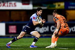 Lloyd Williams of Cardiff Blues is marked by Elliot Dee of Dragons - Ryan Hiscott/JMP - 26/12/19 - SPORT - Arms Park - Cardiff, Wales - Thursday, Dec 26 2019 - Guinness PRO14 Cardiff Blues vs Dragons