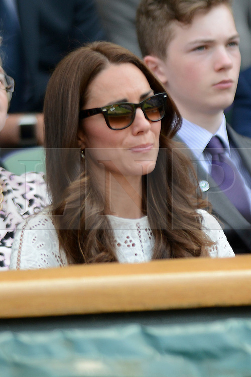 © Licensed to London News Pictures. 2/07/2014. London, UK .  HRH The Duke & HRH The Duchess of Cambridge, Prince William and Kate at Day 9 of the Wimbledon Tennis Championships 2014. Photo credit : Mike King/LNP