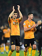 Conor Coady (16) of Wolverhampton Wanderers applauds the travelling fans at full time after a 2-1 win during the Premier League match between Bournemouth and Wolverhampton Wanderers at the Vitality Stadium, Bournemouth, England on 23 November 2019.