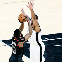 01 May 2017: Houston Rockets guard James Harden (13) takes a jump shot over San Antonio Spurs forward LaMarcus Aldridge (12) during the Houston Rockets 126-99 victory over the San Antonio Spurs, in game 1 of the Western Conference Semi Finals, at the AT&T Center, San Antonio, Texas, USA.