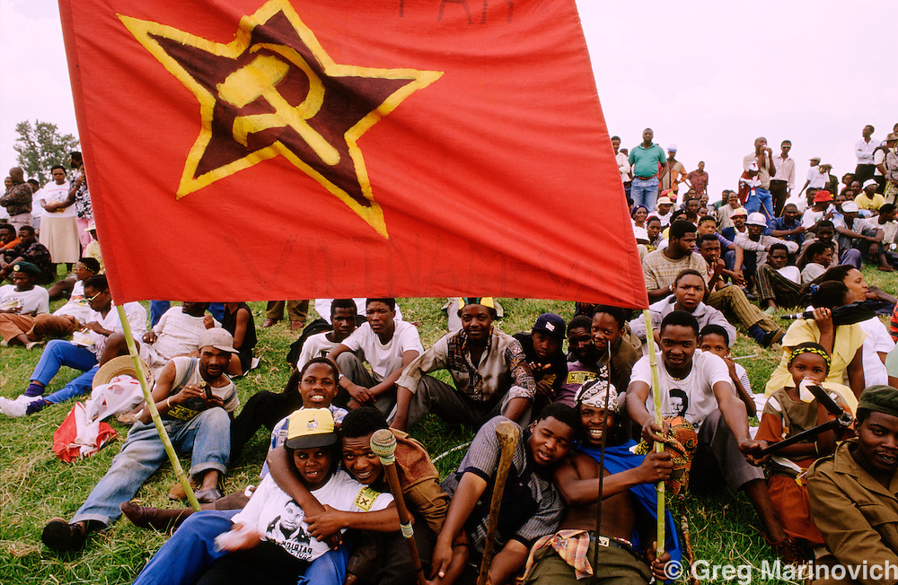 South Africa, 1994: A Communist vflag is carried as People in  ANC regalia attend an election rally on Sharpeville Day 21 March 1994