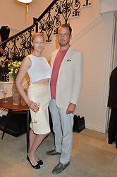 JADE PARFITT and JACK DYSON at the launch of the new Marina Rinaldi flagship store at 5 Albemarle Street, London on 3rd July 2014.
