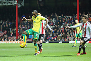 Norwich City striker Cameron Jerome (10) holding off Brentford midfielder Ryan Woods (15) during the EFL Sky Bet Championship match between Brentford and Norwich City at Griffin Park, London, England on 31 December 2016. Photo by Matthew Redman.