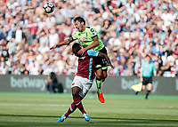 Football - 2016 / 2017 Premier League - West Ham United vs. AFC Bournemouth<br /> <br /> Bournemouth's Adam Smith climbs over Michail Antonio of West Ham to win the header at The London Stadium.<br /> <br /> COLORSPORT/DANIEL BEARHAM