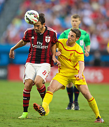 CHARLOTTE, USA - Saturday, August 2, 2014: Liverpool's Joe Allen in action against AC Milan's Riccardo Saponara during the International Champions Cup Group B match at the Bank of America Stadium on day thirteen of the club's USA Tour. (Pic by David Rawcliffe/Propaganda)