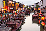 Boats wait for passengers along Shantang canal in Suzhou, China.