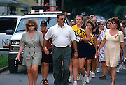 Families of the 21 students and chaperones killed aboard TWA Airlines Flight 800 walk together to a memorial service July 18, 1996 in Montoursville, PA. TWA Flight 800 exploded off East Moriches, NY with the loss of 230 lives.
