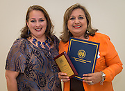 Siomara Saenz-Phillips left, and Luz Lopez, right, pose for a photograph during the Board of Trustees meeting, June 11, 2015.