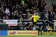 Burton Albion striker Cauley Woodrow (12) celebrates scoring 3-1  during the EFL Sky Bet Championship match between Burton Albion and Brentford at the Pirelli Stadium, Burton upon Trent, England on 18 March 2017. Photo by Richard Holmes.