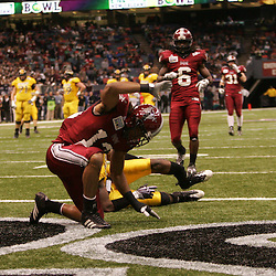 21 December 2008:  Troy defensive back Brandon Lucas (13) celebrates in the endzone after breaking up a pass intended for Southern Miss wide receiver DeAndre Brown (5) who's lower left leg snapped on the play during the first half of a 30-27 overtime victory by the Southern Mississippi Golden Eagles over the Troy Trojans in the  R+L Carriers New Orleans Bowl at the New Orleans Superdome in New Orleans, LA.