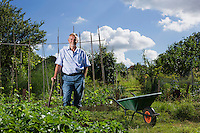 Senior man gardening portrait