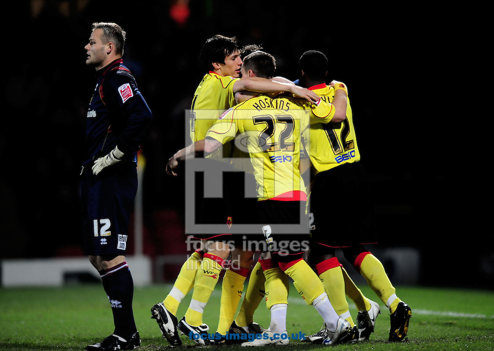 London - Tuesday, January 27th, 2009: Jobi McAnuff of Watford is mobbed by team mates after he scored the first goal past a helpless Brian Jensen (L) of Burnley during the Coca Cola Championship match at Vicarage Road, London. (Pic by Daniel Hambury/Focus Images)