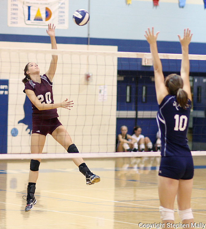 Mt Vernon junior Ali Stark (20) hits the ball over Xavier sophomore Kelly Biermann (10) in their match at the Westside Volleyball Invitational at Jefferson High School in Cedar Rapids on Saturday October 10, 2009. Mt Vernon won the match 21-7, 21-17.