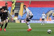 Bolton Wanderer's  Lukas Jutkiewicz passes the ball wide. Skybet football league championship match , Bolton Wanderers v Wigan Athletic at the Reebok stadium in Bolton on Saturday 29th March 2014.<br /> pic by David Richards, Andrew Orchard sports photography.