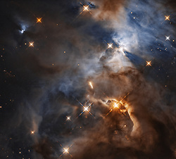 This image, taken with the NASA/ESA Hubble Space Telescope shows the Serpens Nebula, a stellar nursery about 1300 light-years away. Within the nebula, in the upper right of the image, a shadow is created by the protoplanetary disc surrounding the star HBC 672. While the disc of debris is too tiny to be seen even by Hubble, its shadow is projected upon the cloud in which it was born. In this view, the feature — nicknamed the Bat Shadow — spans approximately 200 times the diameter of our own Solar System. A similar looking shadow phenomenon can be seen emanating from another young star, in the upper left of the image.