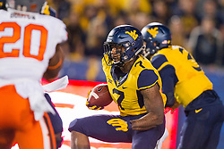 Oct 10, 2015; Morgantown, WV, USA; West Virginia Mountaineers running back Rushel Shell runs the ball up the middle during the first quarter against the Oklahoma State Cowboys at Milan Puskar Stadium. Mandatory Credit: Ben Queen-USA TODAY Sports