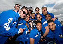Bristol Rovers players celebrate with the Vanarama Football Conference Play-Off Final tropy during the celebration bus tour - Photo mandatory by-line: Dougie Allward/JMP - Mobile: 07966 386802 - 25/05/2015 - SPORT - Football - Bristol - Bristol Rovers Bus Tour