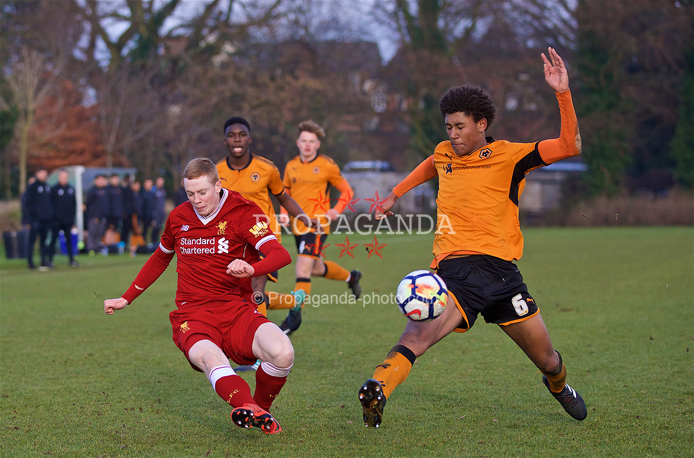 WOLVERHAMPTON, ENGLAND - Tuesday, December 19, 2017: Liverpool's Glen McAuley and Wolverhampton Wanderer's Dion Sanderson during an Under-18 FA Premier League match between Wolverhampton Wanderers and Liverpool FC at the Sir Jack Hayward Training Ground. (Pic by David Rawcliffe/Propaganda)