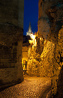 Atmospheric night time shot of an alley at the foot of the Pope's Palace in Avignon, France