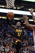 Jan 23, 2016; Phoenix, AZ, USA; Atlanta Hawks guard Dennis Schroder (17) lays up the ball against the Phoenix Suns in the second half at Talking Stick Resort Arena. The Suns won 98-95. Mandatory Credit: Jennifer Stewart-USA TODAY Sports
