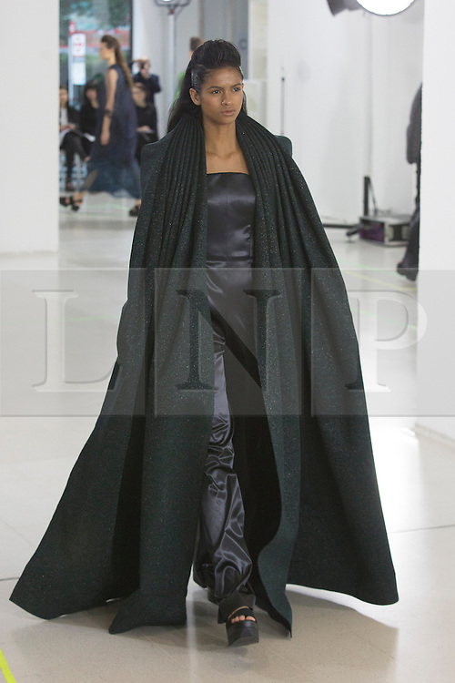 © Licensed to London News Pictures. 03/06/2015. London, UK. Collection by Lucinda Popp. A model walks the runway at the Royal College of Art (RCA) MA Fashion graduate fashion show.  Photo credit : Bettina Strenske/LNP
